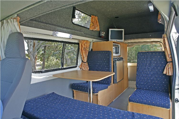 Seats and table in 4 berth campervan