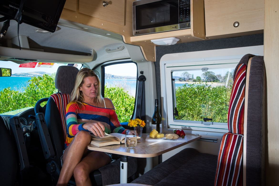 Lady having lunch in motorhome
