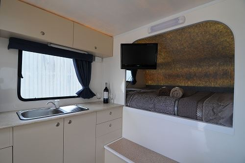 Kitchen and bed in 2 berth motorhome