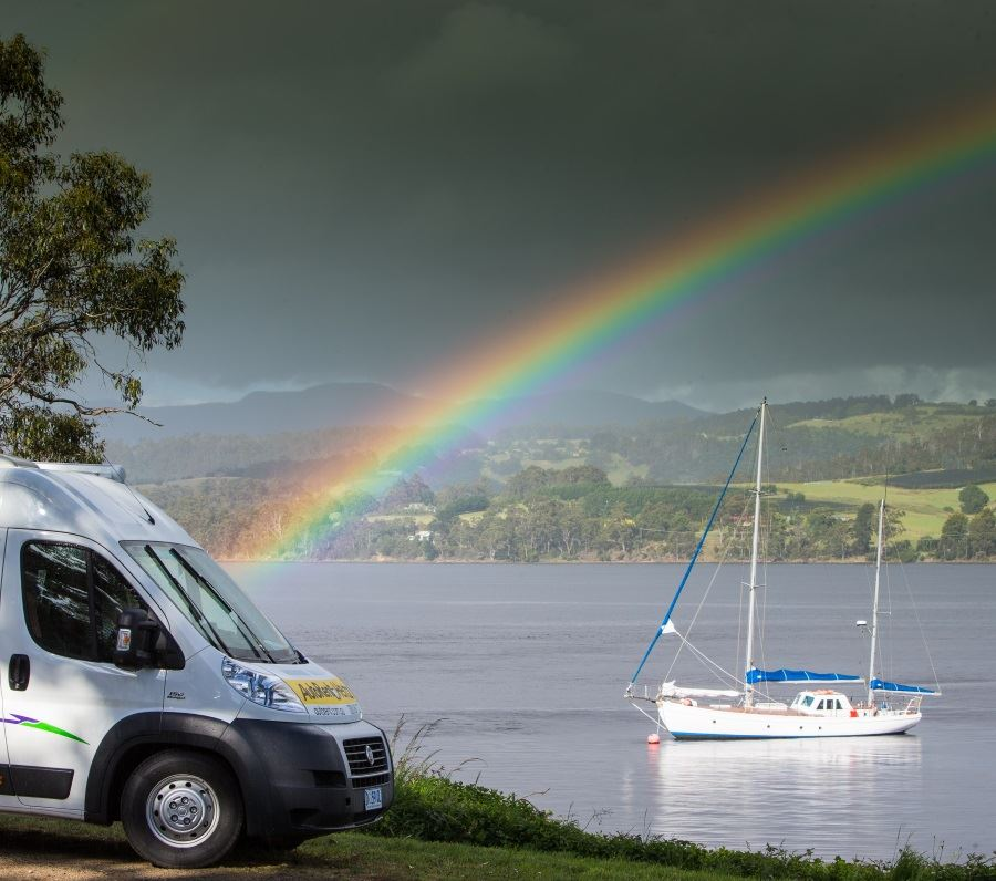 Campervan with raindbow