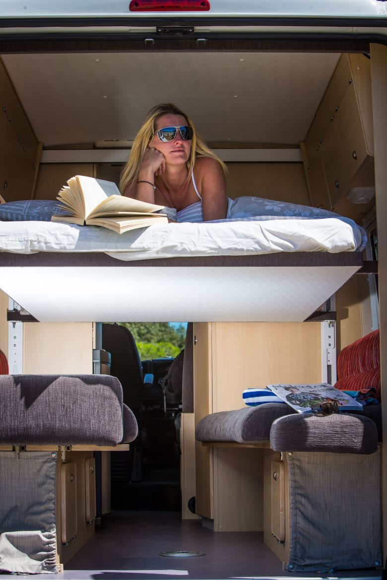 Lady relaxing in motorhome